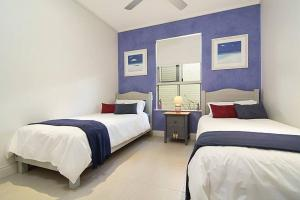 A bed or beds in a room at Whispering Palms