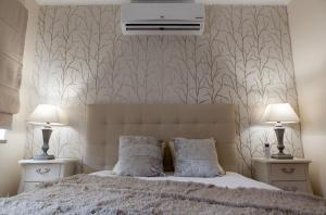 Uma cama ou camas num quarto em Casa d'Avenida
