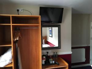 A television and/or entertainment center at The Queen's Hotel Wetherspoon