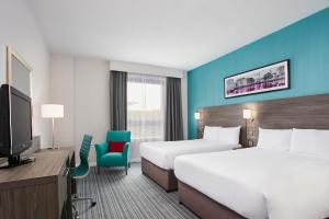 A bed or beds in a room at Jurys Inn Plymouth