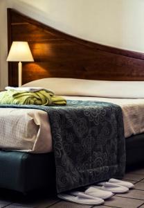 Letto o letti in una camera di Hotel Sirenetta