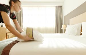 Uma cama ou camas num quarto em Mercure Lisboa Almada