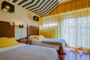 Cama o camas de una habitación en Hotel Principe Real