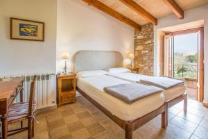 A bed or beds in a room at Sa Carrotja - Adults Only