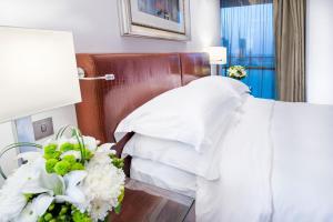 Un ou plusieurs lits dans un hébergement de l'établissement Burjuman Arjaan by Rotana - Dubai