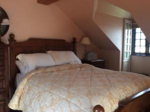 A bed or beds in a room at Marsh Mere Lodge