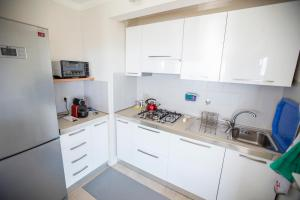 A kitchen or kitchenette at Central Park Apartment by Connexion