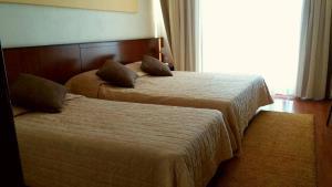 Ένα ή περισσότερα κρεβάτια σε δωμάτιο στο Ξενοδοχείο Ακροπόλ