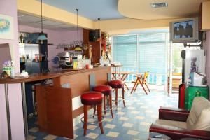 The lounge or bar area at Villa Amadeus