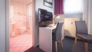 A kitchen or kitchenette at Excelsior Bochum