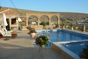 The swimming pool at or close to Lesvos Tower House Komninos