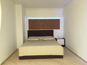 Кровать или кровати в номере Apartment Inzhenernaya 108/62