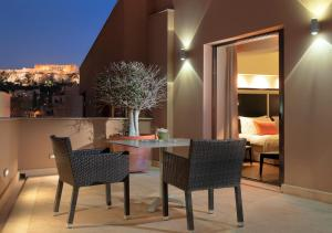 A balcony or terrace at O&B Athens Boutique Hotel