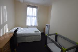 A bed or beds in a room at York Hotel