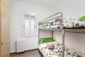 A bunk bed or bunk beds in a room at Matarolux 4
