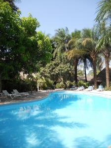 The swimming pool at or near Hotel Les Palétuviers Kaloa