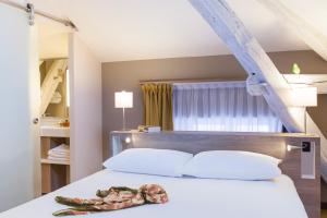 Un ou plusieurs lits dans un hébergement de l'établissement ibis Styles Chaumont Centre Gare