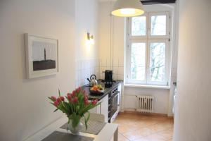 Küche/Küchenzeile in der Unterkunft Nollendorf Apartments