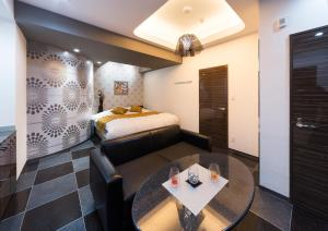 A bed or beds in a room at Hotel Noi (Adult Only)