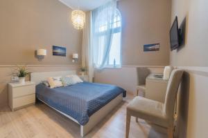 Łóżko lub łóżka w pokoju w obiekcie Due Passi Apartamenty w Sopocie