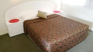 A bed or beds in a room at A&A Lodge Motel