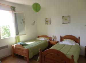 Un ou plusieurs lits dans un hébergement de l'établissement Gite De Costebelle