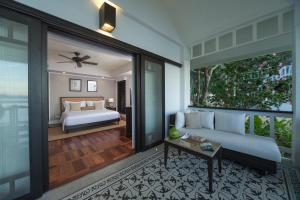 A bed or beds in a room at El Nido Resorts Lagen Island