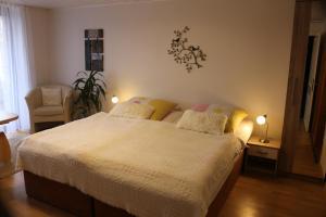 Ein Bett oder Betten in einem Zimmer der Unterkunft Rügenurlaub 1
