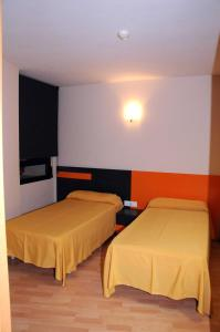 A bed or beds in a room at Llagotel
