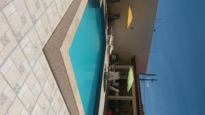 The swimming pool at or near Casa Portuguesa 27