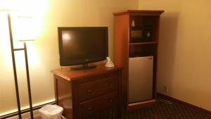 A television and/or entertainment center at Dartmouth Motor Inn