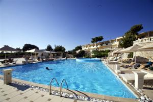 The swimming pool at or near Mabely Grand Hotel