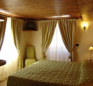 Кровать или кровати в номере Hotel Dente Del Gigante