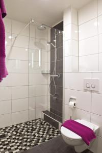Ein Badezimmer in der Unterkunft Hotel Berg