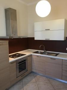 A kitchen or kitchenette at Vip Bergamo Apartments