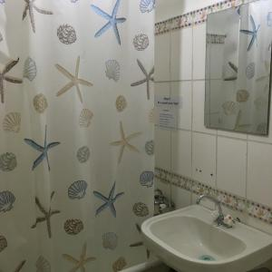 Ein Badezimmer in der Unterkunft UB Guesthouse