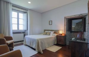 A bed or beds in a room at Pazo de Sedor