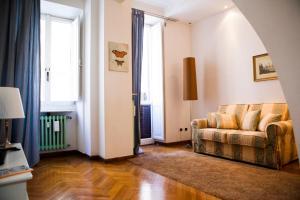 Coin salon dans l'établissement Piazza di Spagna Rome Apartments