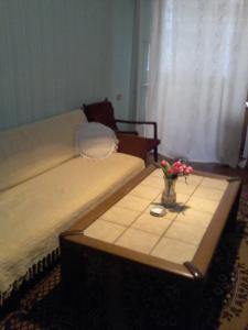 A bed or beds in a room at Guest House Tengiz
