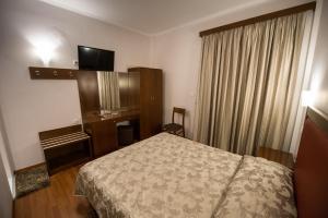 Ein Bett oder Betten in einem Zimmer der Unterkunft Hotel Olympos