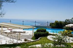 Der Swimmingpool an oder in der Nähe von Palace Hotel San Michele