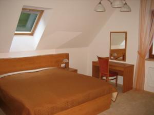 Postel nebo postele na pokoji v ubytování Hotel Bazant