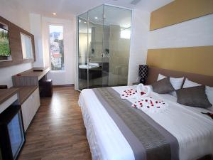 A bed or beds in a room at New Sun Hotel