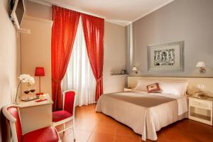A bed or beds in a room at Ottaviano Guest House