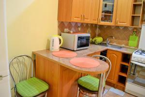 A kitchen or kitchenette at Central Flat on Halytska Str