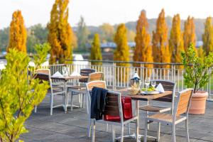 Ein Restaurant oder anderes Speiselokal in der Unterkunft Mercure Hotel Potsdam City