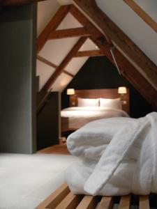 Ein Bett oder Betten in einem Zimmer der Unterkunft Texel Suites