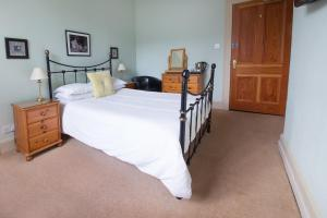 A bed or beds in a room at The Park Guest House, Stornoway