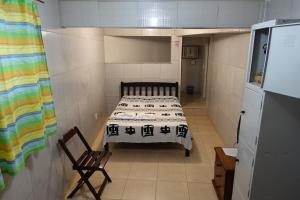A bed or beds in a room at Pousada Favela Cantagalo