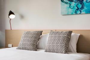 Postelja oz. postelje v sobi nastanitve Greenacre Hotel